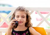 children kid girl talking mobile phone indented smiling
