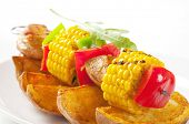 Skewer with corn and meat with vegetables