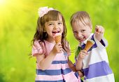 picture of ice cream cone  - Children with icecream cone outdoor in hot summer day - JPG