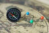 Compass And Marking Pins On Blur Vintage World Map, Journey Concept, Copy Space poster