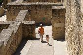 Tourists Visiting Medina Azahara, Cordoba, Spain poster