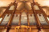 stock photo of pipe organ  - Beautiful organ with a lot of pipes angle shot - JPG