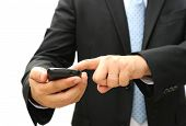 Business Man Holding And Touching A Smart Phone.