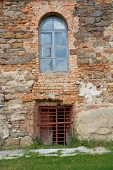 picture of carmelite  - Old orange brick wall with windows in Monastery  - JPG