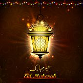 stock photo of eid ka chand mubarak  - illustration of illuminated lamp on Eid Mubarak background - JPG