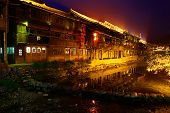 Night illumination of homes in large Chinese village, Zhaoxing Dong Village, Liping, Guizhou, China