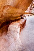 Ancient water channel carved in the walls of Siq in Petra, Jordan