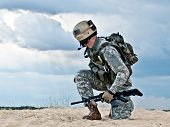 stock photo of battlefield  - US soldier in the desert during the military operation - JPG