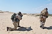 picture of battlefield  - Two soldiers in the desert during the military operation - JPG