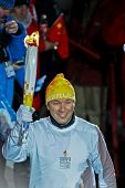 INNSBRUCK, AUSTRIA - JANUARY 13 Fritz Strobl carries the olympic fire during the opening ceremony at the Bergisel stadium on January 13, 2012 in Innsbruck, Austria.