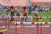 DONETSK, UKRAINE - JULY 11: Girls compete in semi-final of 100 m hurdles during 8th IAAF World Youth