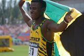 DONETSK, UKRAINE - JULY 14: Gold medalist in 200 metres Michael O'Hara of Jamaica with national flag