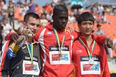 DONETSK, UKRAINE - JULY 14: Medalists in triple jump on medal ceremony during 8th IAAF World Youth C