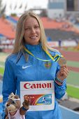 DONETSK, UKRAINE - JULY 14: Alena Lutkovskaya of Russia with her silver medal in pole vault during 8th IAAF World Youth Championships in Donetsk, Ukraine on July 14, 2013