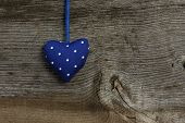 Blue Dotted Love Valentine's Heart Hanging On Wooden Texture Background