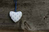 White Blue Pattern Love Valentine's Heart Hanging On Wooden Texture Background