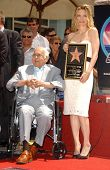 Johnny Grant and Michelle Pfeiffer at the ceremony honoring Michelle Pfeiffer with the 2,345th star