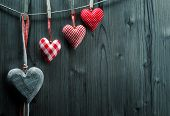 Valentine's Day wallpaper - Textile hearts hanging on the rope ascending order