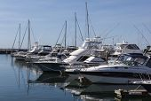 Yacht Or Motor Boat At Harbor Moored At Marina. Port  Stephens. Nelson Bay.  Australia.