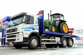Volvo FM 370 Truck And John Deere 1640 Tractor As Cargo