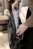 Businesswoman Packing/Unpacking Laptop