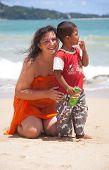 Patong - May 03: Russian Woman Hugs A Thai Child