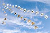 Flock Of Flying Books In Blue Sky