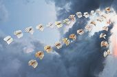 Flock Of Flying Books In Storm Clouds