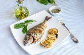 Grilled Dorada Fish With Lemon And Spinach