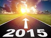 image of road trip  - road to the 2015 new year and sunrise background - JPG