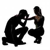 Silhouette of one sad Asian man squat and his wife give comfort to him, full length portrait isolated on white background.
