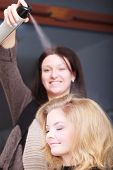 picture of hairspray  - Hairstylist With Hairspray And Female Client Blond Girl In Salon - JPG
