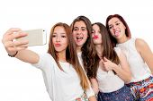 Group Of Girlfriends Taking Selfie.