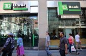 NEW YORK CITY - FRIDAY, JUNE 20, 2014:   Pedestrians walk past TD Bank, N.A. in New York City on Fri