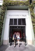 UNIVERSAL CITY, CALIFORNIA - TUES. JUNE 24, 2014: Shoppers walk past an Abercrombie & Fitch clothing storel in Universal City, California, on Sunday, June 22,  2014.