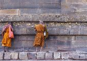 Two Buddhist Monks Talking To The Dhamekh Stupa.