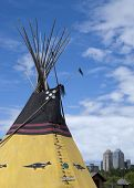 Indian Tipi With Calgary Skyline In Background.