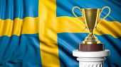 Golden trophy with Swedish flag in background