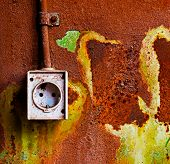 Old Electrical Outlet On Rusty Iron Wall