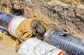 pic of pipe-welding  - Welder welding a pipe on a terrain - JPG