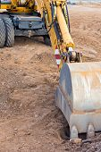 stock photo of backhoe  - Wheel loader excavator with backhoe at construction site - JPG