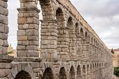 stock photo of aqueduct  - Roman aqueduct ancient monument in Segovia Spain
