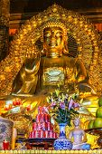 Giant Golden Buddha Statue In Temple With Coca-cola Offer In Front.