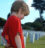 Child In Cemetery With Flag