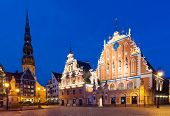 Famous House of Blackheads on the Town Square in Riga with a Church of St. Peter in the back. Latvia