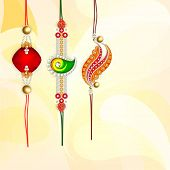 Beautiful rakhi's on bright yellow background for Happy Raksha Bandhan celebrations.