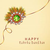 Beautiful rakhi on beige background for Happy Raksha Bandhan celebrations.