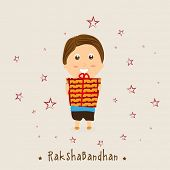 Cute little boy holding gift boxes on stars decorated grey background for Happy Raksha Bandhan celeb