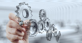 pic of mechanical drawing  - businessman hand draws gear to success concept - JPG