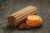 True Cinnamon Sticks And Dried Oranges